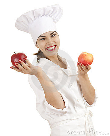 Female cook with red apples