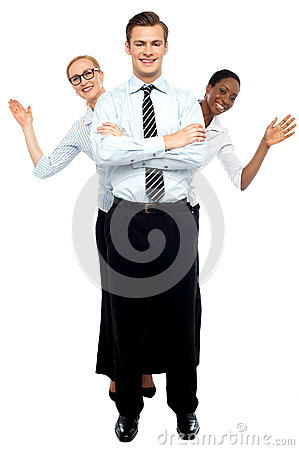 Female corporate waving hi while man stands tall