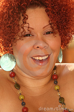 Female with Curly Red Hair and Bright Jewelry