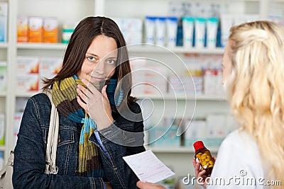 Female Customer Purchasing Medicine From Pharma