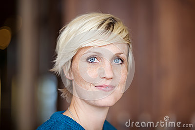 Female Customer Smiling In Restaurant