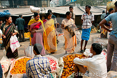 Female customers talk with traders of Flower Market Editorial Image
