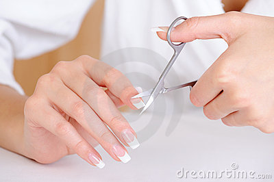 Female cutting nail on the  index finger