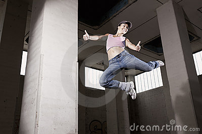 Female Dancer Jumping With Thumbs Up. Royalty Free Stock Photo - Image: 19995205