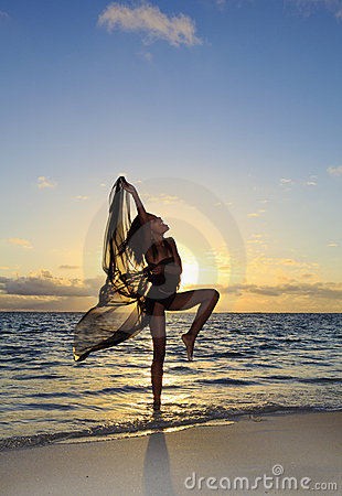 Female dancer standing in the ocean