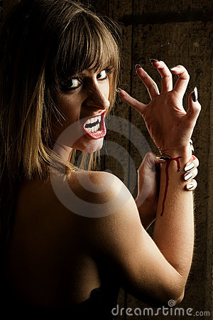 Female dangerous Vampire is cutting her wrists
