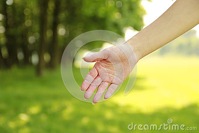 Female disclosed gentle hands on nature