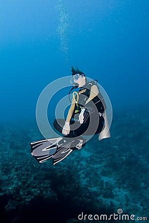 Female diver hovering