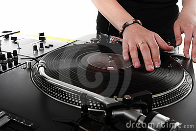 Female DJ scratching the vinyl record