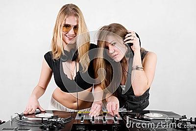 Female Djs mixing vinyl
