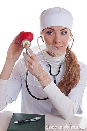 Female docotr examining red heart