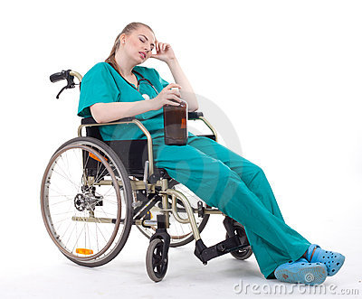 Female doctor with alcohol on wheelchair