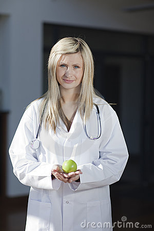 Female doctor with an apple in her hand