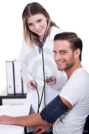 Female doctor checking blood pressure