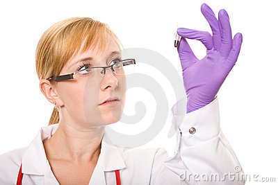 Female doctor checks carefully sample of blood