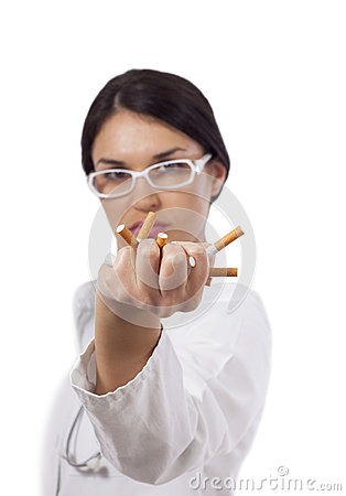 Female doctor crushing cigarettes