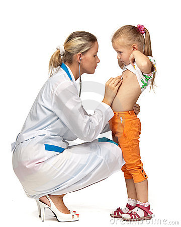 Female  doctor examining a child