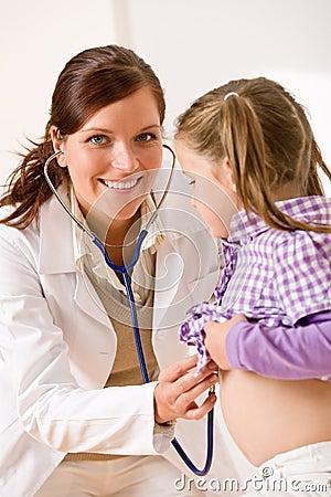Female doctor examining child with stetoscope