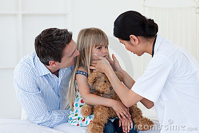 Female doctor examining little girl