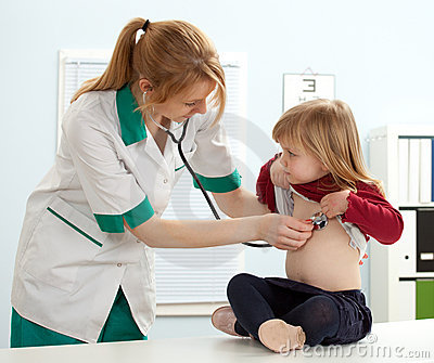 Female doctor examining  little girl