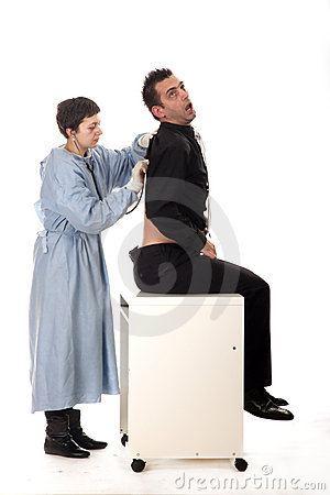 Female doctor examining scared patient