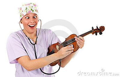 Female doctor examining a violin with stethoscope