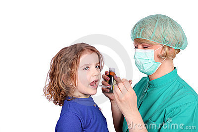 Female doctor gives a little girl a cure