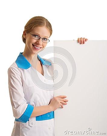 Female doctor holding a blank billboard