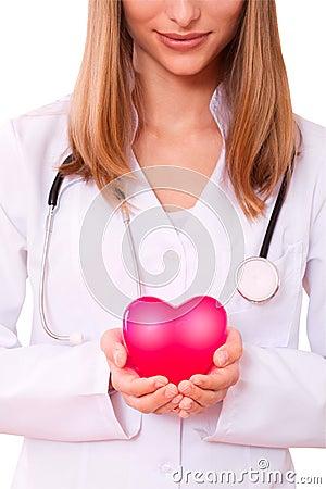 Female doctor holding heart.