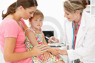 Female doctor injecting child