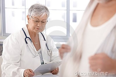 Female doctor looking at papers
