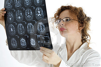 Female doctor looking at tomography brain