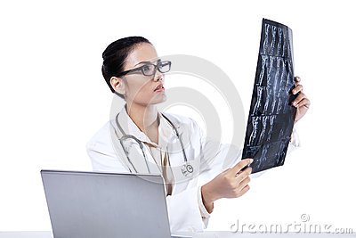 A female doctor looking at x-ray results