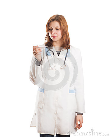 Female doctor looks at the thermometer