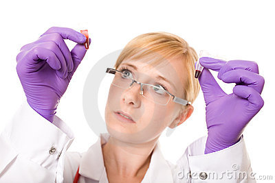Female doctor or nurse compare two blood samples