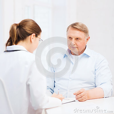 Female doctor or nurse with old man prescrbing