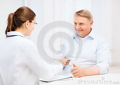 Female doctor with old man giving prescription