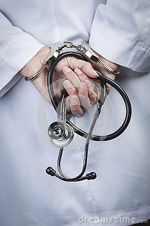 Free Female Doctor Or Nurse In Handcuffs Holding Stethoscope Royalty Free Stock Images - 33983799