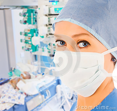 Female doctor in pediatric intensive care unit