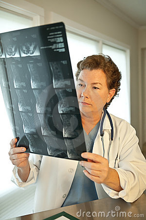 Female Doctor Reading MRI Film Scans