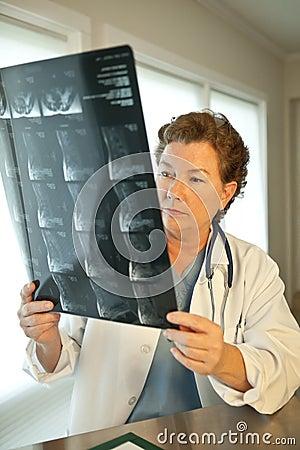 Female Doctor Reading MRI Film Scans