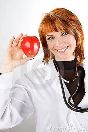female doctor showing red apple