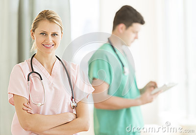 Female Doctor Standing Arms Crossed At Hospital
