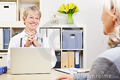 Female doctor talking with senior