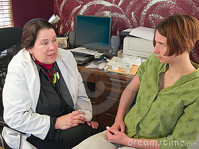 Female doctor talking to concerned patient