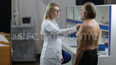 Female doctor using stethoscope to exam patient stock video footage