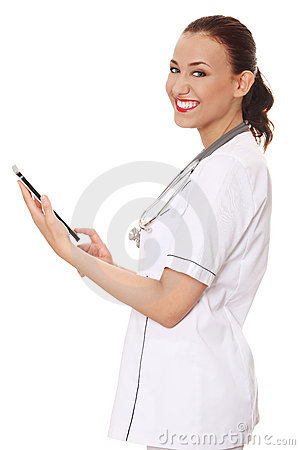 Female doctor using tablet computer.