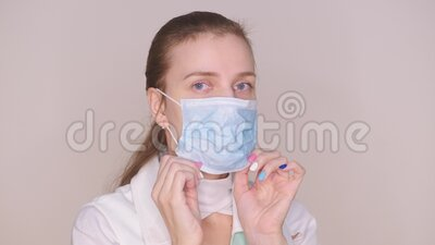 Female doctor wearing protective blue mask stock footage