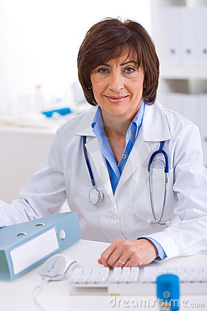 Female doctor working at office