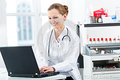 Female doctor writing on Pc in her clinic
